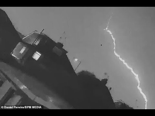 Shocking moment a bolt of lightning strikes passenger plane with 'loud bang' just after it takes off