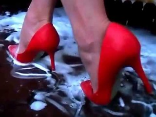 Washing cars in red high heels