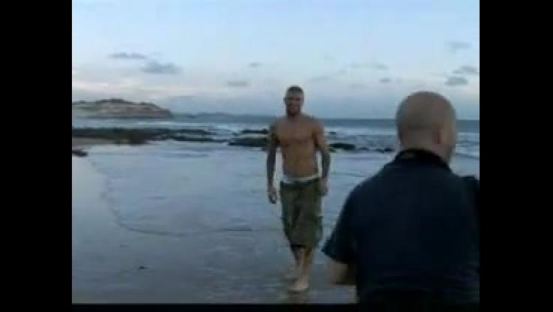 Topless David Beckham in beach