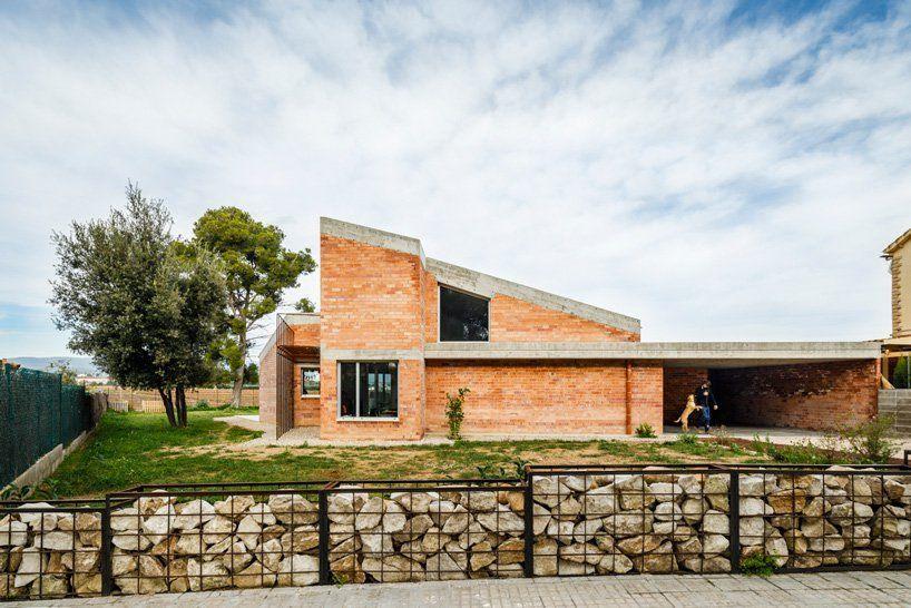 Jesús Perales builds casa almudena as an asymmetrical brick residence in Spain