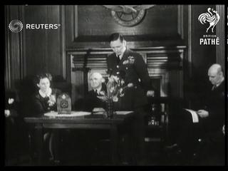 Air Marshall presents awards to Belgian heroine Andree de Jongh (1946)