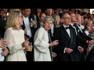 Crazy Theresa May dances and sings to Abba hits at posh black-tie music festival