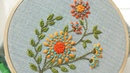 Hand embroidery of a flower motif with chain stitch and french knots