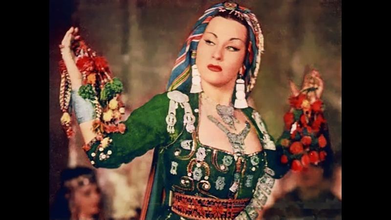 Има Сумак (Yma Sumac), настоящее имя Соила Аугуста Императрис Чаварри дель Кастильо (13.09.1922 — 01.11.2008) исполняет песню G
