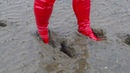 Jana goes to the Wadden Sea with her shiny red high heel overknee boots